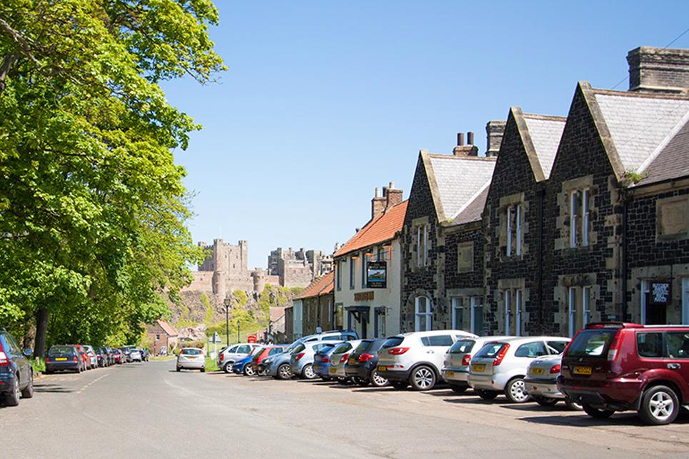 Bamburgh village - view towards bamburgh castle, where to stay in Bamburgh, where to eat in Bamburgh, places to eat Bamburgh village