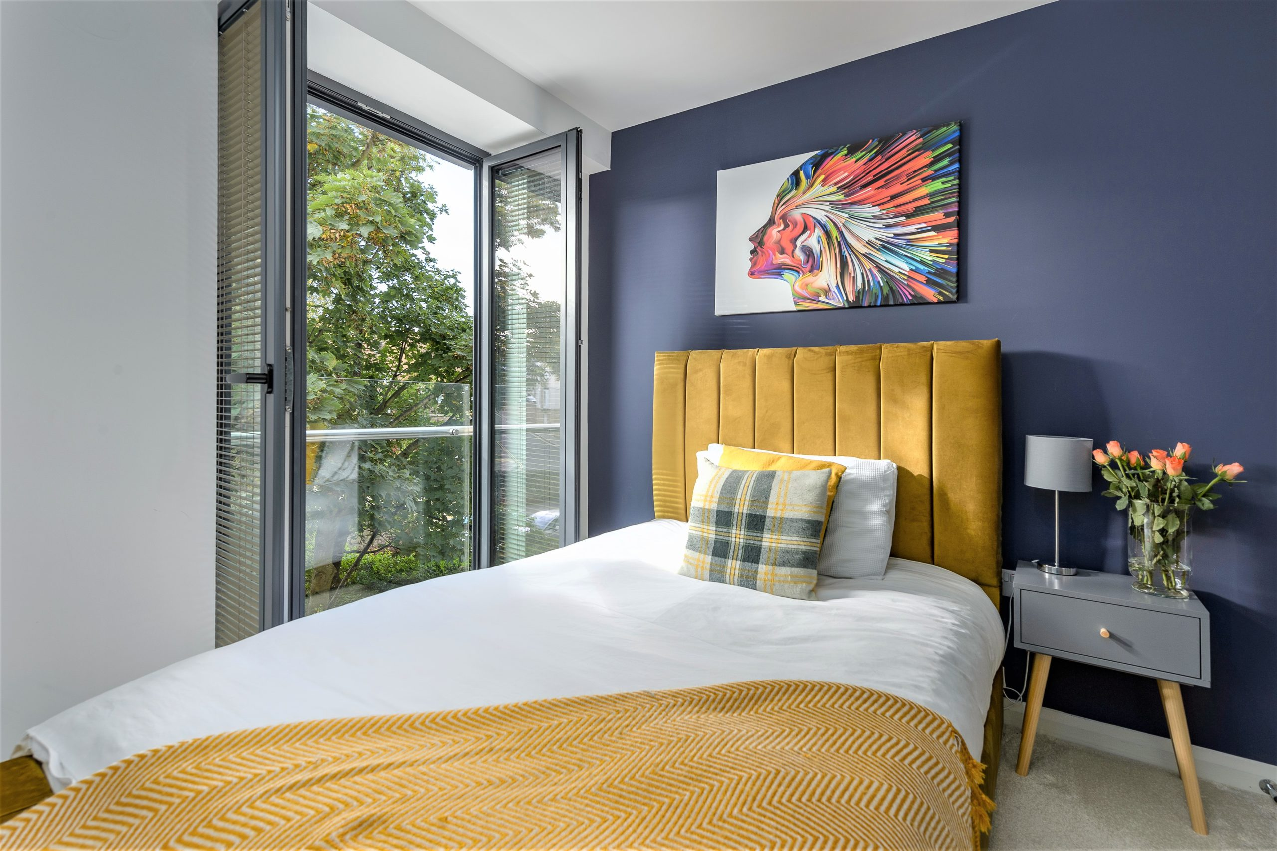 single bedroom with a small balcony at the baker's dozen 5 star luxury accommodation in alnwick views of the castle and gardens northumberland beach and sea harbour
