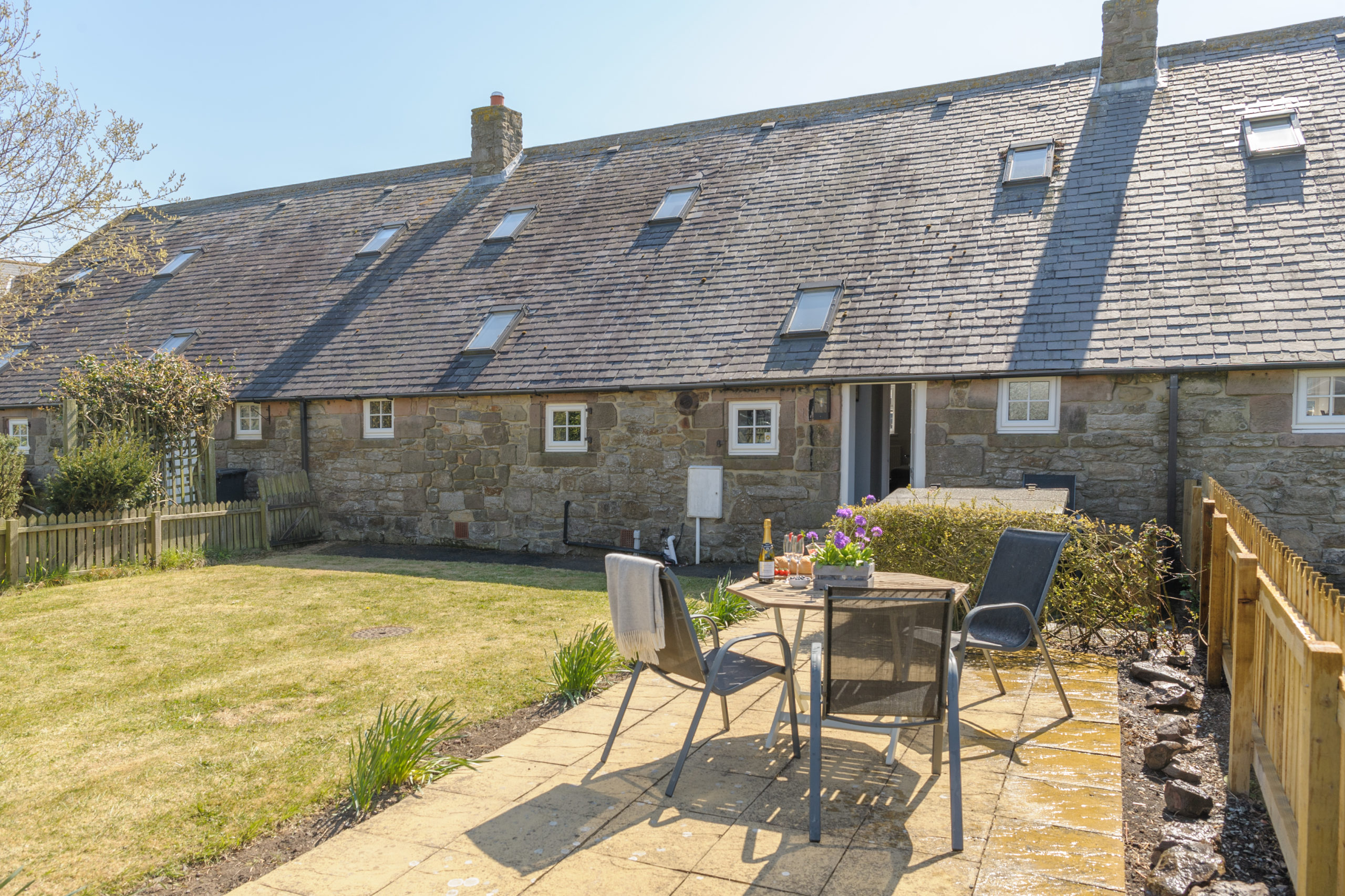 outdoor garden at the oystercatcher beadnell northumberland seaside harbour beach coastal holiday cottage luxury