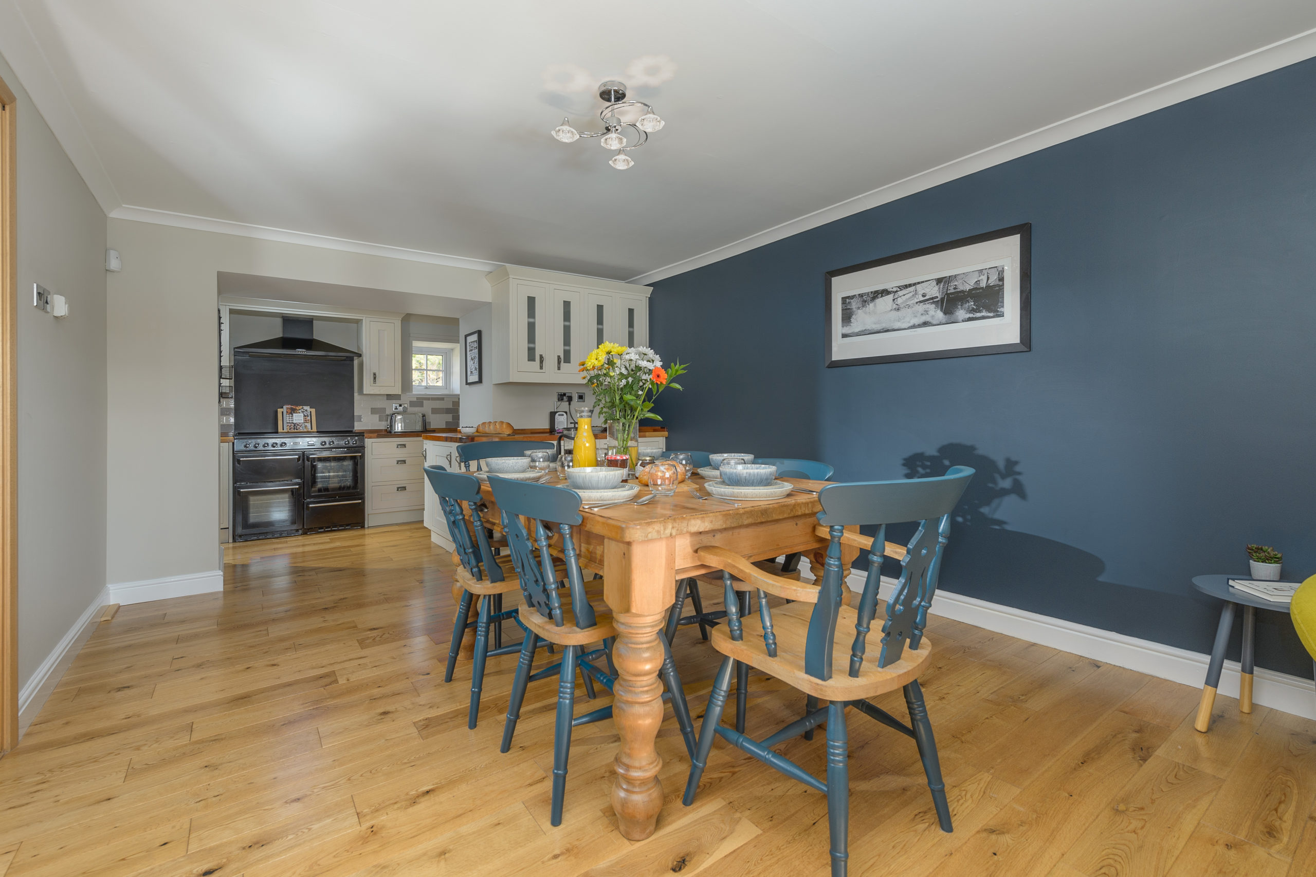 dining table and kitchen at the oystercatcher beadnell northumberland seaside harbour beach coastal holiday cottage luxury