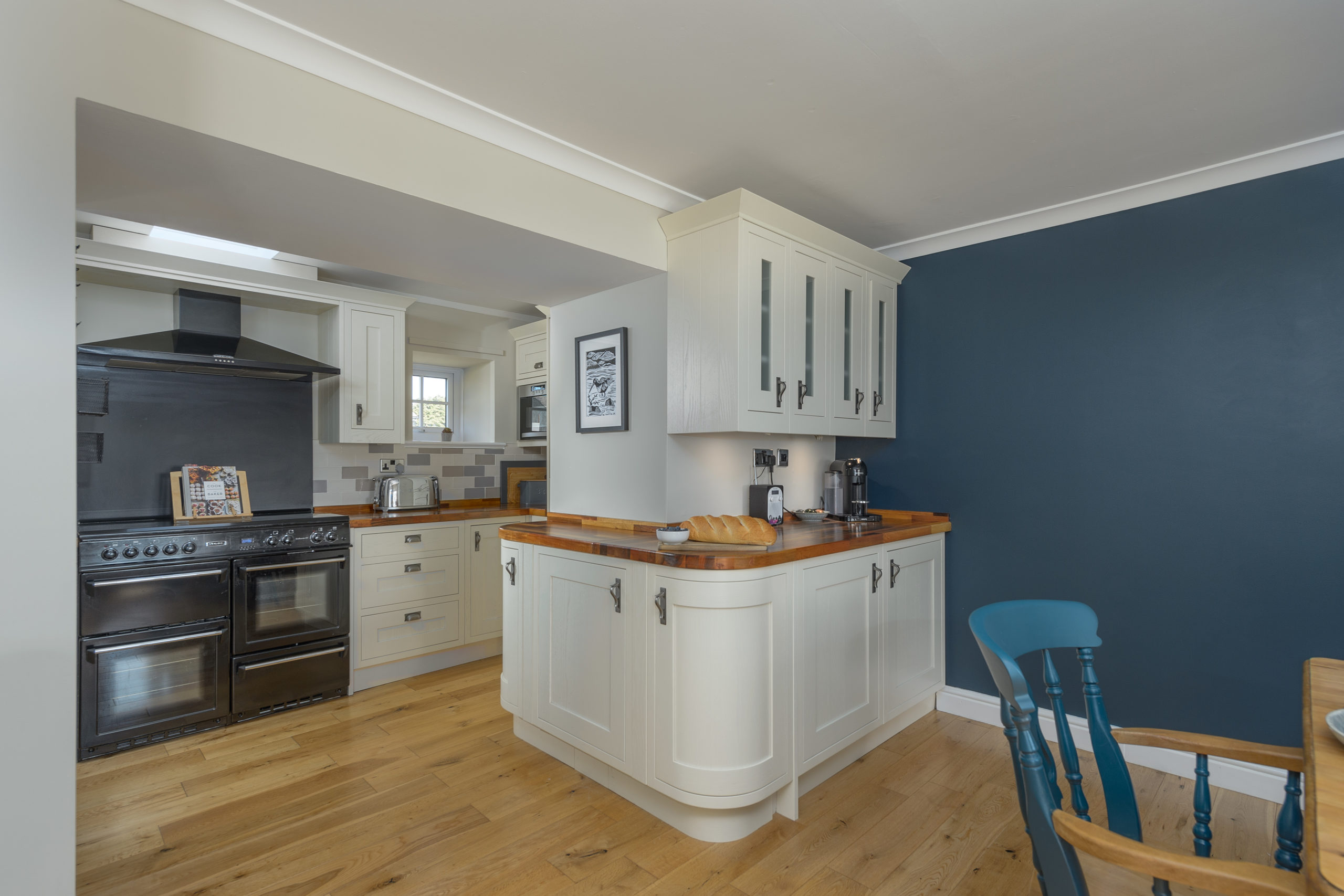 kitchen and dining table at the oystercatcher beadnell northumberland seaside harbour beach coastal holiday cottage luxury